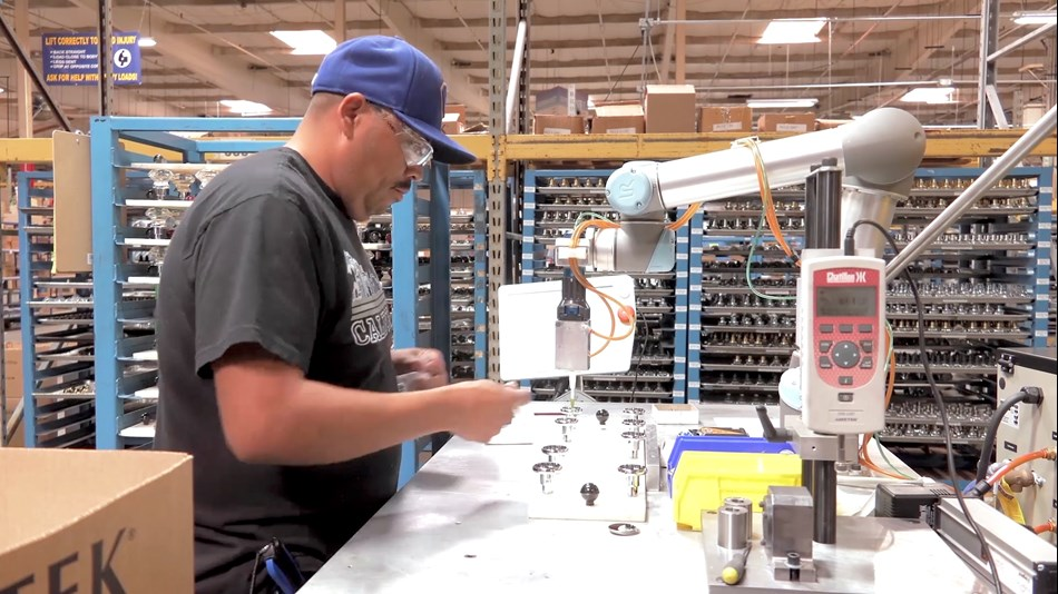 The UR5 cobot and the operator work in tandem, doubling the production output per man-hour