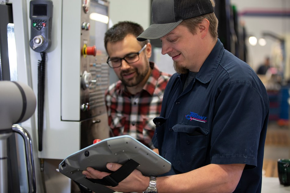 After Troy Ojalehto (left) at Rapid Design Solutions, a Certified Systems Integrator of Universal Robots, developed the initial application, Toolcraft's automation engineer, Brian Laulainen (right), was able to handle the daily operation in addition to developing a parts rinsing and drying station as an application add-on for the UR5e. Laulainen did the training through the UR Academy, then supplemented with a few hours hands-on training with Ojalehto.