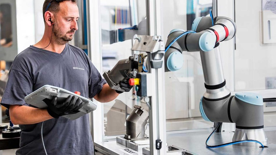 Man with UR16e collaborative robot