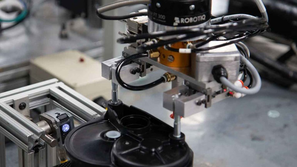 The cobot communicates with the printers via email communication