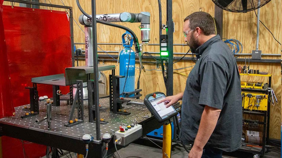 Man programs collaborative robot welding solution
