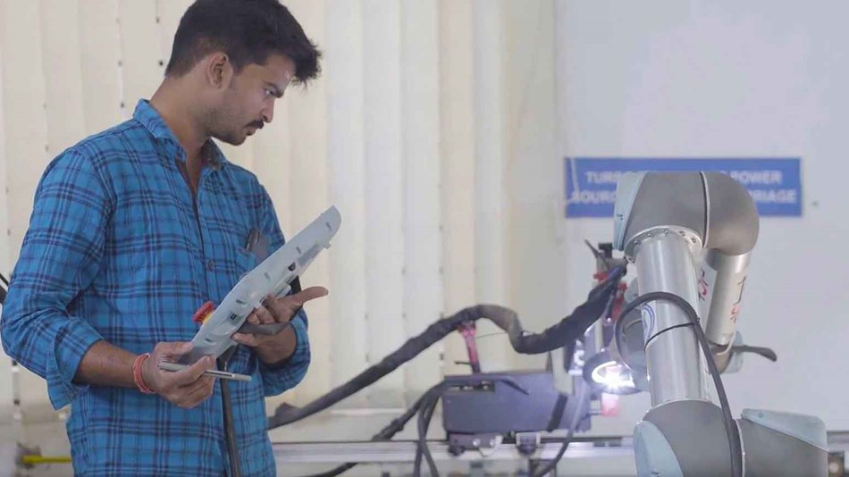 Application engineer programming UR5 for welding at PSG College, Coimbatore