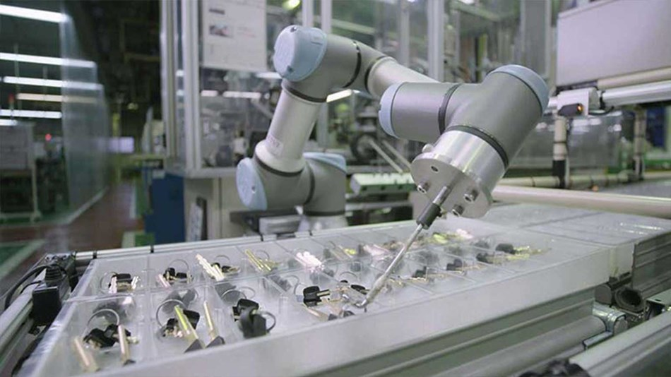 Alpha Corporation in Japan first considered deploying industrial robots to tend injection molding machines but abandoned the idea since the company did not have enough space to erect safety fencing.