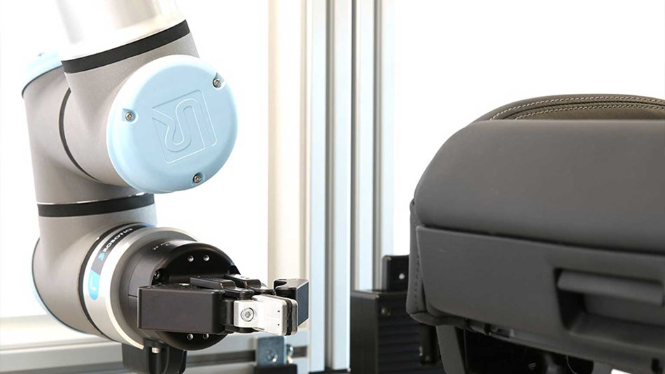 The UR10e is equipped with a UR+ certified gripper from Robotiq that actuates buttons and switches on the car seats.
