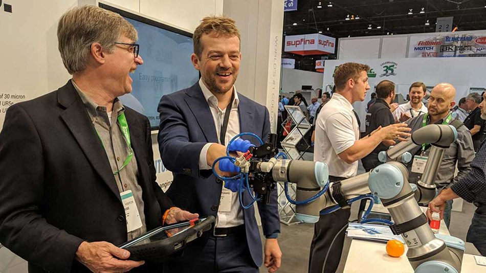 Partner handshake: CEO of Soft Robotics Carl Vause (left) demonstrates his company's new UR+ certified gripper to Universal Robots' founder Esben Østergaard.