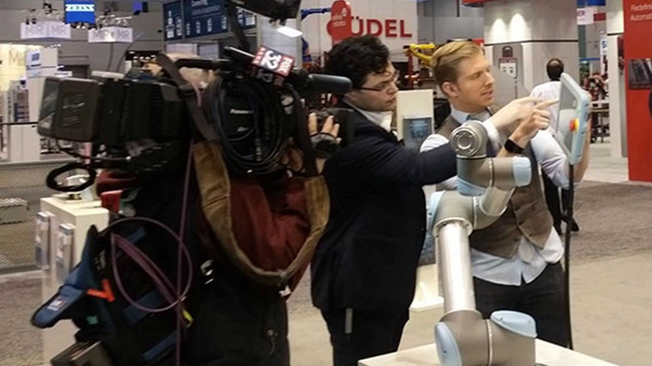 robots available show attendees how they simply grab a robot arm and teach it a move